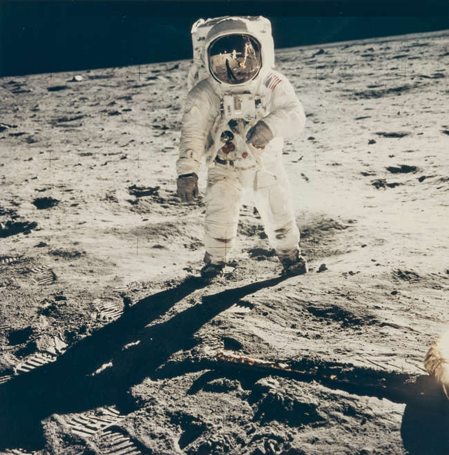 Armstrong (Neil) Buzz Aldrin with the LM and Armstrong reflected in his...