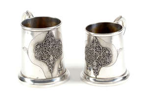 16  Two Italian silver coloured tapering mugs