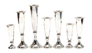 4  A set of seven variously sized Italian silver coloured candlesticks by Guido di Ricci Alberti Zipoli for Brandmarte