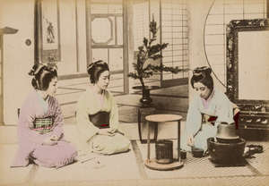 102  Japan.- Four Photograph Albums, containing a total of 195 hand-coloured albumen prints, one in cloth, the rest contemporary red lacquer with decorated upper covers, oblong 8vo, [c.1890].